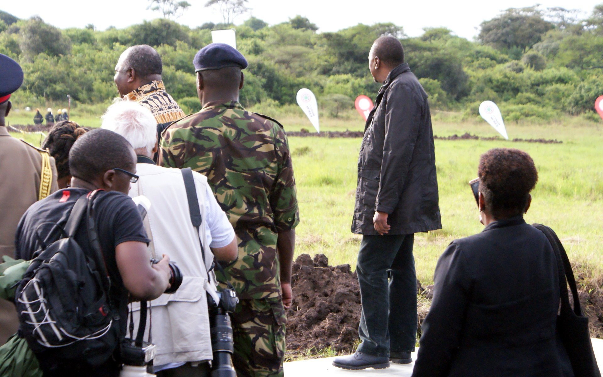President Uhuru looks on as the ivory burns. He and President Ali Bongo of Gabon had just delivered their speeches.
