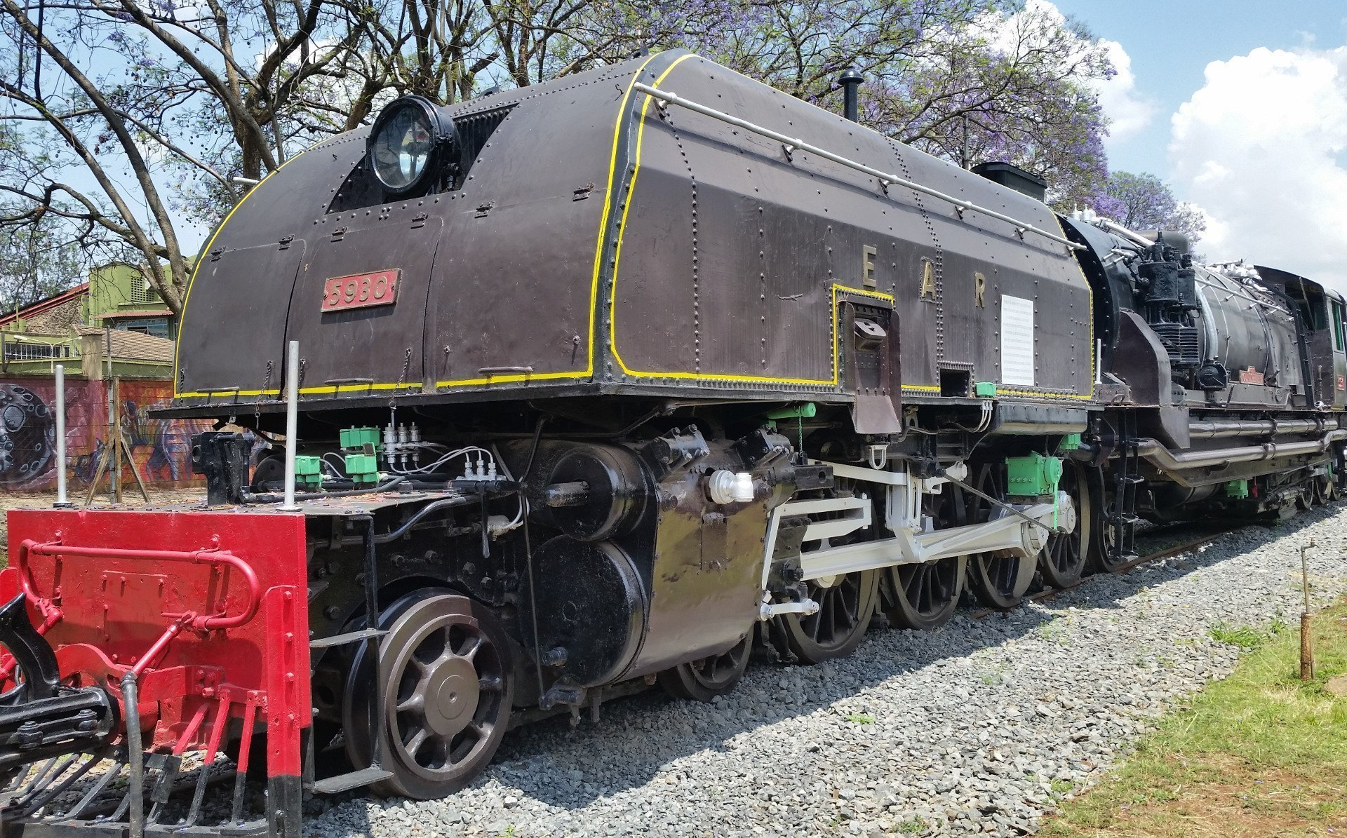 Popularly known as the Mighty Garratt, this 59 Class locomotive was the biggest, heaviest and most powerful steam locomotive ever made on 1 M gauge. It was specifically made for Kenya and introduced in 1955 after WWII to haul large freight lying at the port of Mombasa. These class of trains were named after mountains because of their massive nature. This one was named after Mount Shengena in Tanzania.