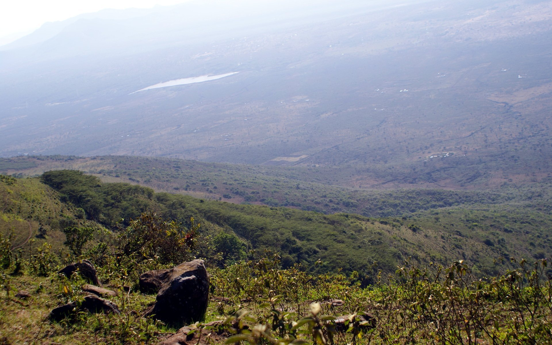 A view of the Rift Valley from Ngong Hills with Maasai homesteads barely visible in the valley.