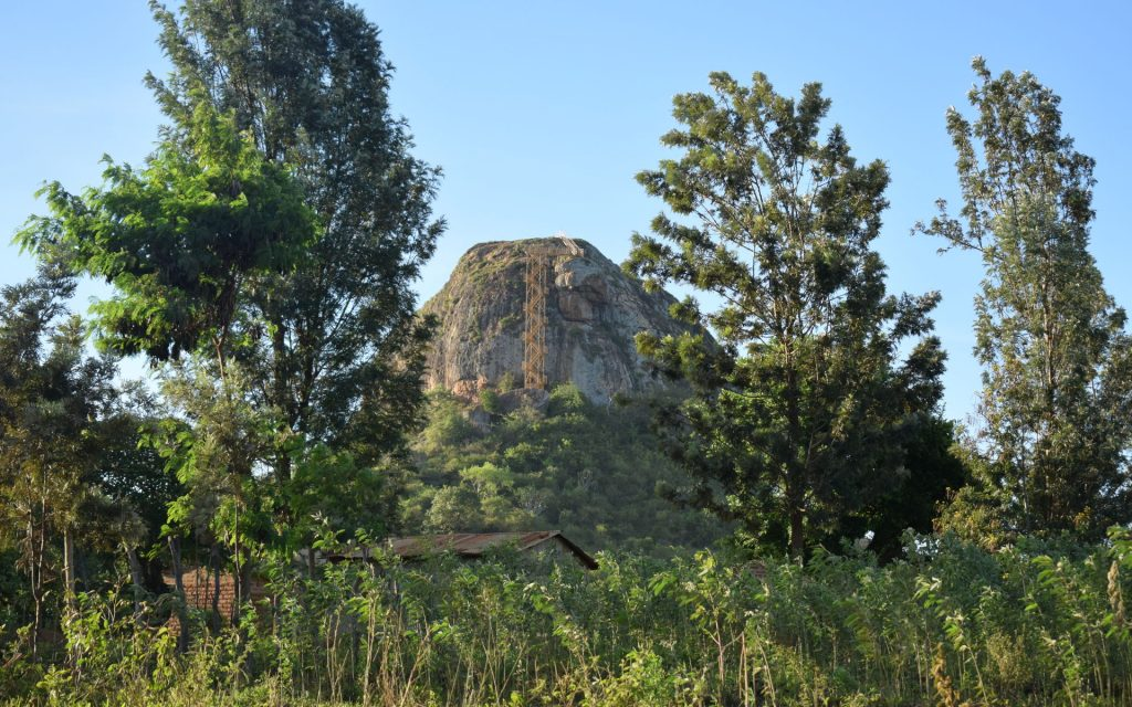 A few winding turns past Kyuluni and about 10 KM from Kitui, stands the legendary 183 M (600 F) high rock outcrop called the Nzambani Rock.