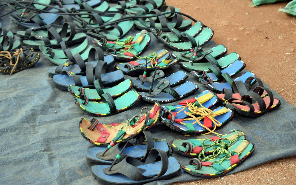 Like all other markets, Zombe has its fair share of peripheral traders who come to sell a range of products, including some famous sandals made from vehicle tyres.