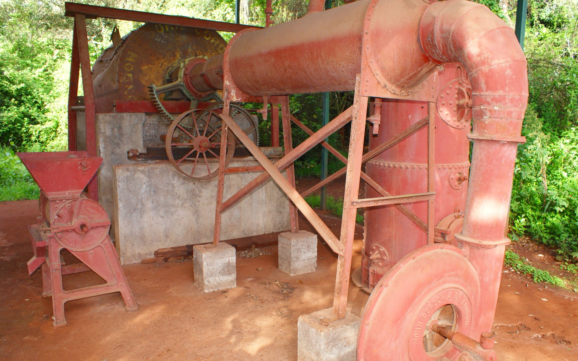 The roasting machine that Karen used to process coffee from her farm was a behemoth of a contraption. Located some distance from the house, this particular one is sadly a replica.