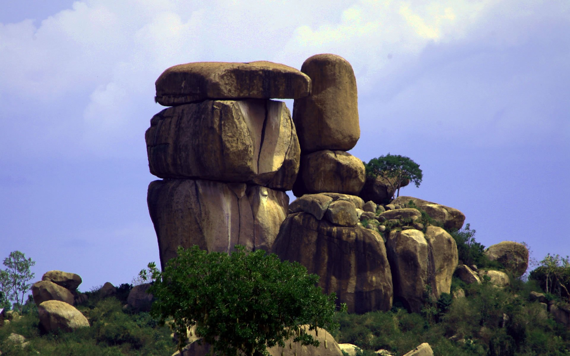 Kit Mikayi, are massive towers of boulders piled together into gravity-defying columns dipped in mystery and legend.
