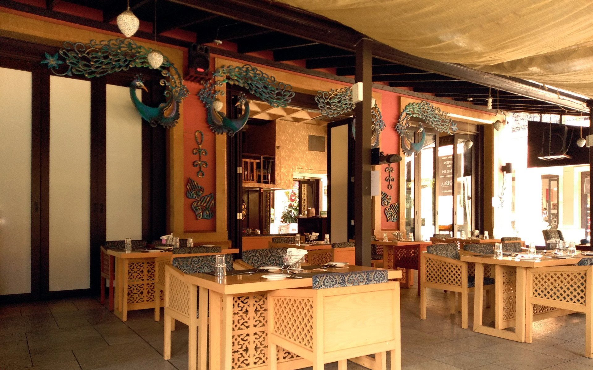 Overlooking an artificial lakeside on the ground floor of The Hub Karen is The Mayura Restaurant.